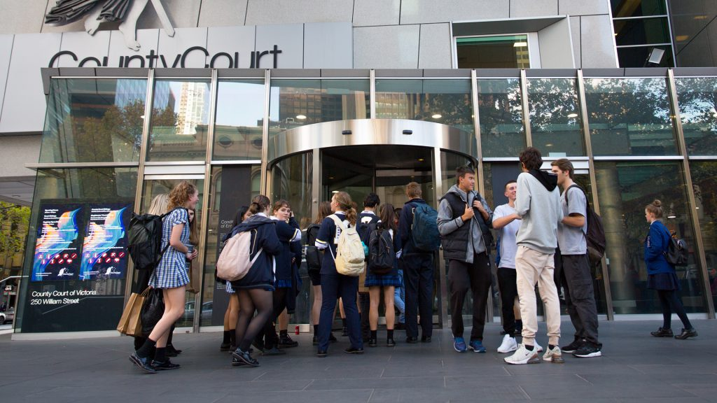 High school students standing out the front of the County Court revolving doors
